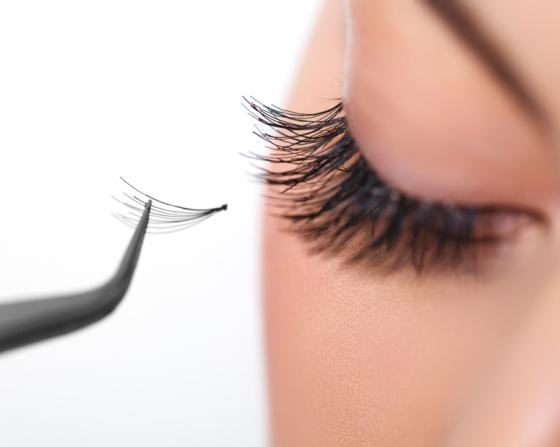 Woman applying eyelash extensions